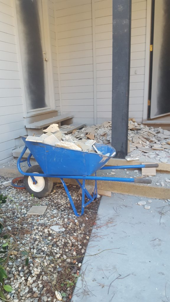 junk removal marin, a wheelbarrow full of construction material
