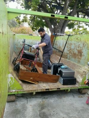 Junk removal, we load the dumpster for you