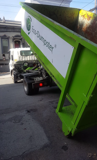 junk removal job, our bin is unloaded for loading ease.